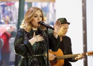 El tierno acto de Adele con los bomberos tras la tragedia del edificio en Londres